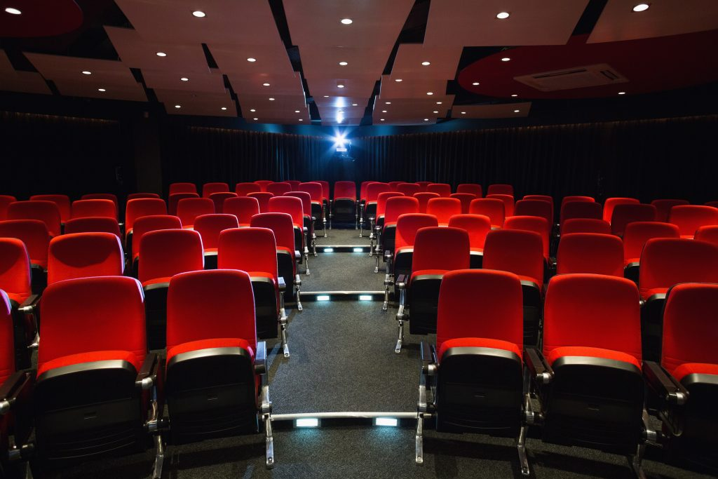 Empty rows of red seats at the cinema